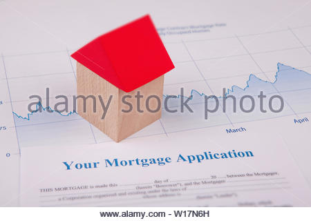 An empty mortgage application form with house - Stock Photo