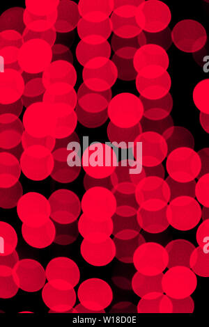 Unfocused abstract red bokeh on black background. defocused and blurred many round light. - Stock Photo
