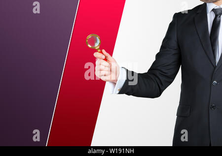 Unrecognizable businessman holding magnifying glass. Business concept - Stock Photo