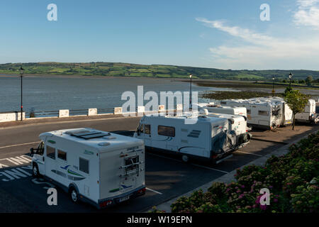 Caravans parked near Dungarvan Park at the mouth of River Colligan. The area is designated for coaches. Dungarvan Ireland. - Stock Photo