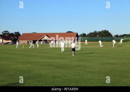 Village Cricket, match, game, sport, Thornham, Norfolk, England, UK - Stock Photo