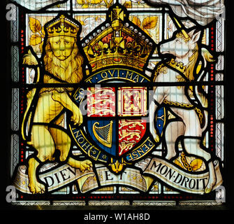 The royal arms in stained glass (c.1887) by Heaton, Butler & Bayne in the Church of the Holy Innocents, Great Barton, Suffolk, England - Stock Photo