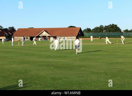 Village Cricket, match, game, sport, Thornham, Norfolk, England, UK 2 - Stock Photo
