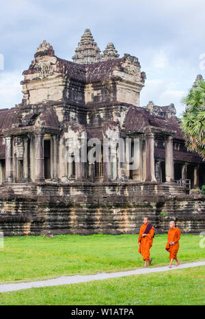 Budhist monks at the Angkor Wat Temple in Siem Reap Cambodia - Stock Photo