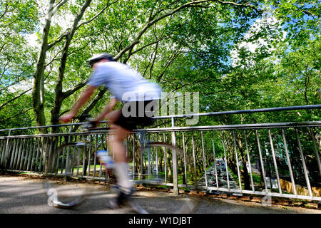 Dortmund, Germany, 16.June.2019: Racing cyclists on the pedestrian bridge over the Federal Highway No.1 (Bundesstrasse 1) in the area Rheinlanddamm / Signal-Iduna. - Stock Photo