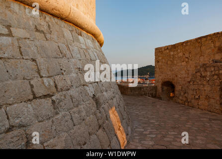 View of city from wall surround showing Minceta tower in warm light from the setting sun,Dubrovnik,Croatia - Stock Photo
