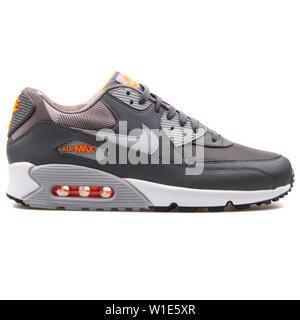 VIENNA, AUSTRIA - AUGUST 25, 2017: Nike Air Max 90 Print dark grey sneaker on white background. - Stock Photo