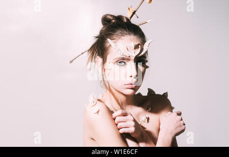 Woman with horns and thorns fantasy creature. Mystic fairy tail character. Halloween ideas concept. Girl with thorns as devil dragon magical creature. - Stock Photo