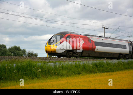 Virgin Class 390 Pendolino Train on the Northampton Loop of the West Coast Main Line on a Summer Evening - Stock Photo