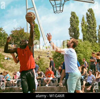 young lads playing baskeball in Mauerpark - Stock Photo
