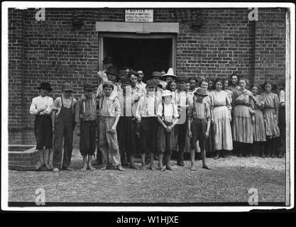 Part of the force at Tupelo Cotton Mills. All work. Smallest ones not in photo. Among youngest here are, Coleman Miller, been working one year, can not write his name, said 12 years old but doesn't appear to be. Zamie Scott, one year working. Tupelo, Miss. - Stock Photo