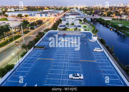 Miami Florida canal downtown skyline dusk rooftop parking lot car canal street city lights - Stock Photo