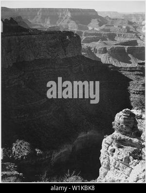 View of darkly shadowed canyon at left and center, from the South Rim, 1941, Grand Canyon National Park, Arizona. (vertical orientation), 1941 - Stock Photo