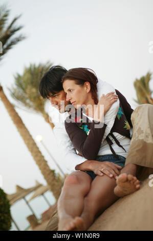 Couple hugging on the beach - Stock Photo
