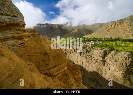 Young woman, hiker, trekker in the surreal landscape typical for Mustang in the high desert around the Kali Gandaki valley, the deepest valley in the - Stock Photo