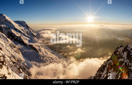 Sunset over the valley of Chamonix, sea of clouds and fog, view from Cosmiques hut, Chamonix, Haute-Savoie, France - Stock Photo