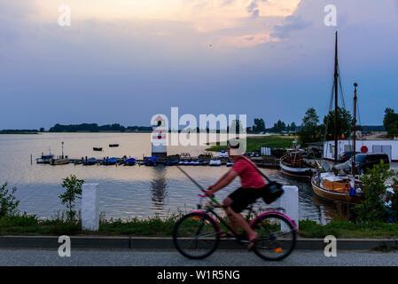 Boy with bike and fishing in Waase village on Ummanz, Ruegen, Baltic Sea coast, Mecklenburg-Vorpommern, Germany - Stock Photo