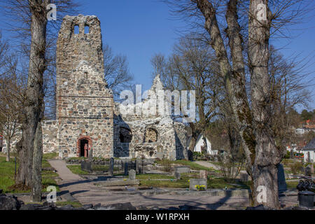 St Olaf Church ruins and surrounding graveyard in the ancient town of Sigtuna, Sweden - Stock Photo