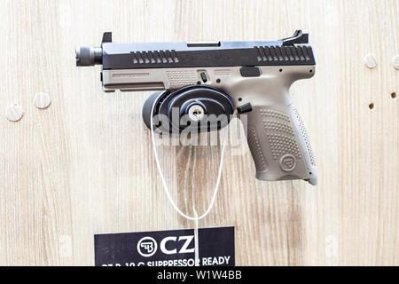 Poznan, Poland, Feb 2019 CZ semi-automatic pistol made by Czech firearm manufacturer CZUB in Czech Republic, exposition, KNIEJE Hunting shooting fair - Stock Photo
