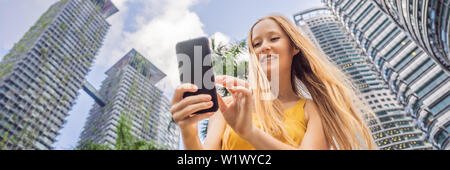 Woman Tourist using navigation app on the mobile phone. Navigation map on a smartphone in a big city BANNER, LONG FORMAT - Stock Photo
