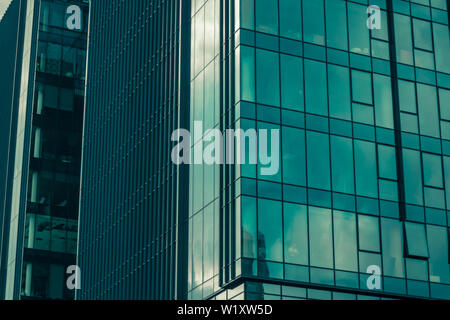Sky with clouds reflected in windows of modern office building. Business background. - Stock Photo