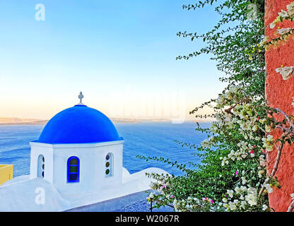 traditional greek Orthodox chapel at Oia village Santorini island Cyclades Greece - Stock Photo