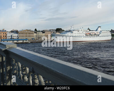 Cruise ship Ocean Majesty at English embankment in Saint-Petersburg, Russia viewed from Blagoveshchensky bridge - Stock Photo