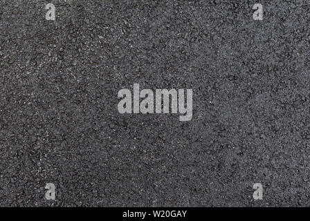 High resolution full frame textured background of wet, gray asphalt, viewed from above. - Stock Photo