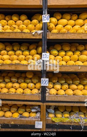 Pile of fresh yellow ripped Thai mango names Mamuang Kaew displayed on fruits stall shop - Stock Photo