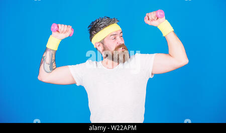 Use weights or dumbbells. Man bearded athlete exercising dumbbell. Athlete training with tiny dumbbell. Motivated athlete guy. Sportsman training with dumbbells blue background. Improve your muscles. - Stock Photo