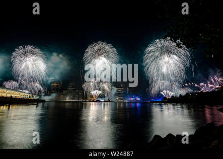 Independence day celebration in New York City with Macy's Fireworks in Lower Manhattan on East River and Brooklyn Bridge; July 4, 2019; New York; USA - Stock Photo