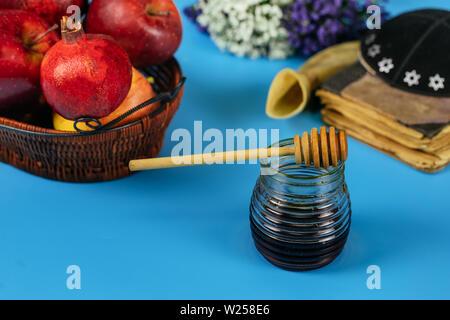Apples, pomegranate and honey for Rosh Hashanah jewish holiday torah book, kippah a yamolka - Stock Photo