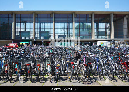 Heidelberg, Germany - June 2019:  Many parked bicycles in front of Heidelberg main station - Stock Photo