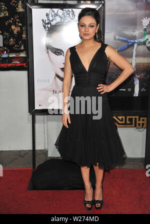 LOS ANGELES, CA. November 11, 2010: Mila Kunis at the Los Angeles premiere of her new movie 'Black Swan', the closing film of the 2010 AFI Fest, at Grauman's Chinese Theatre, Hollywood. © 2010 Paul Smith / Featureflash - Stock Photo