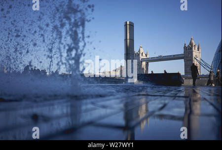 London, UK - February, 2019. View of the Tower Bridge from the South Bank with a water fountain on the foreground. - Stock Photo