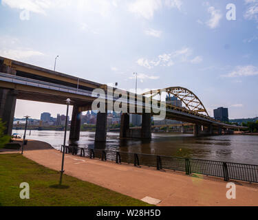 The Fort Duquesne Bridge, connecting the north shore to downtown as seen from the north side as it crosses the Allegheny river, Pittsburgh, PA, USA - Stock Photo