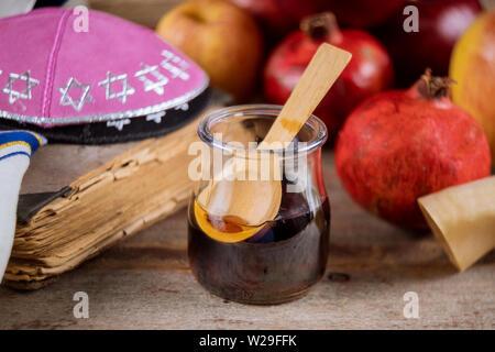 Apples, pomegranate and honey for Rosh Hashanah jewish holiday torah book, kippah a yamolka talit - Stock Photo