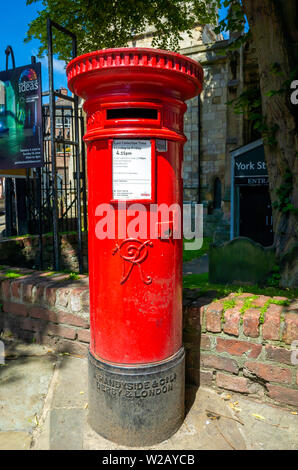 An old post box from Victorian times with insignia VR for Victoria Regina in York City Centre - Stock Photo