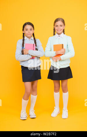Knowledge day. School day fun cheerful moments. Kids cute students. Schoolgirls best friends excellent pupils. Secondary school. Schoolgirls tidy appearance school uniform. School friendship. - Stock Photo