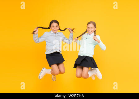 Secondary school. Kids cute students. Schoolgirls best friends excellent pupils. Schoolgirls tidy appearance school uniform. School friendship. Knowledge day. School day fun cheerful moments. - Stock Photo