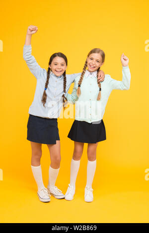 September again. Childhood happiness. School day fun cheerful moments. Kids cute students. Schoolgirls best friends excellent pupils. Schoolgirls tidy appearance school uniform. School friendship. - Stock Photo