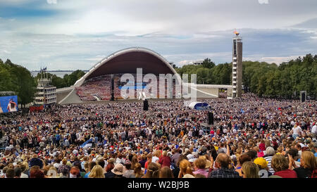 Tallinn, Estonia - July 07, 2019: Estonian XXVII National song and dance festival called My Fatherland is My Love. Crowd at Song festival Grounds in E - Stock Photo