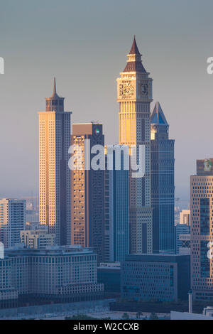 UAE, Dubai, Downtown Dubai, elevated view of skyscrapers on Sheikh Zayed Road from downtown, dusk - Stock Photo