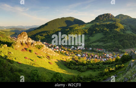 Beautiful landscape of valley in Slovakia mountains, small houses in village, rural scene, majestic picturesque view at sunset panorama - Stock Photo