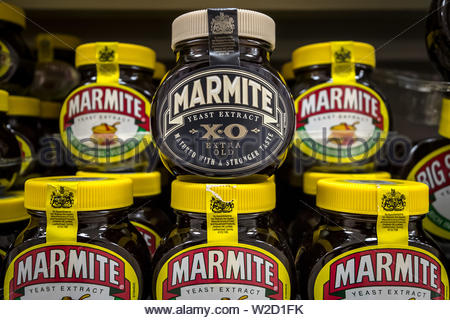 """London, UK. 8th July 2019. Marmite XO (extra old) goes on sale today. First launched as a limited edition nearly a decade ago, the XO version of the popular savoury spread is back after consumer demand. The extra strong version has been matured for 28 days - four times longer than the classic version to give it a """"more intense full-bodied taste"""", according to its maker Unilever. Credit: Guy Corbishley/Alamy Live News - Stock Photo"""