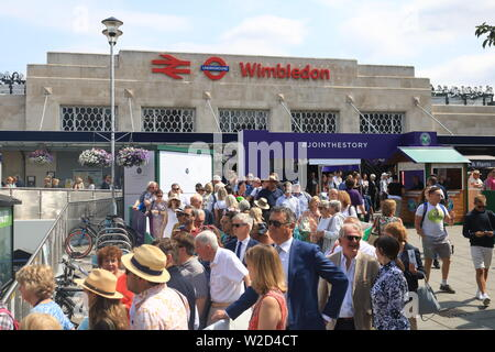 Wimbledon, London. UK. 8th July 2019. Large crowds arrive at Wimbledon station to attend the matches at the All Enngland Tennis Club  on the second Monday which is also referred to as Manic Monday as it is the busiest day of the Wimbledon Championships with the last 16 matches taking place  for  men's and Ladies 's singles of the tennis tournament . Credit: amer ghazzal/Alamy Live News - Stock Photo