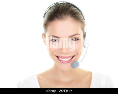 Customer service representative headset woman talking giving online help desk support looking at camera friendly happy and smiling isolated on white background. Asian / Caucasian female girl 20s. - Stock Photo