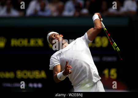 Wimbledon, London, UK. 8th July, 2019. Rafael Nadal serving to Joao Sousa during their fourth round match against at Wimbledon today. Credit: Adam Stoltman/Alamy Live News - Stock Photo