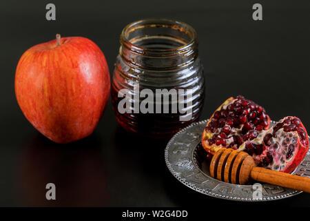Apples, pomegranate and honey for Rosh Hashanah jewish holiday - Stock Photo