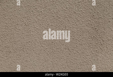 Plastered, painted, rough and beige or light brown concrete or stone wall. High resolution full frame textured background. - Stock Photo